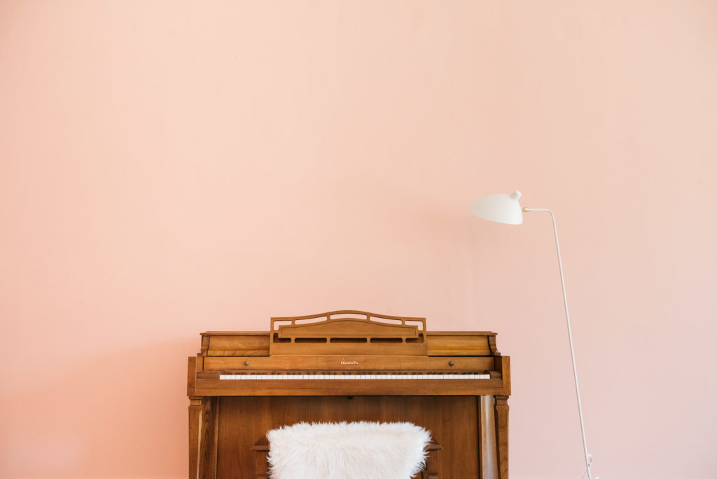 red cloud studio, molly blythe, sks, sarah kuchar studio, music lessons, interior design, pink wall, neon sign, pink chair, piano, orange chair, music studio design, voice lesson, piano lesson, piano teacher, vocal coach, voice teacher, chicago, illinois, photographer, iron and honey, melissa ferrara, architectural, architecture, pink wall, neon sign, pink chair, orange chair
