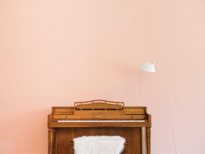red cloud studio, molly blythe, sks, sarah kuchar studio, music lessons, interior design, pink wall, neon sign, pink chair, piano, orange chair, music studio design, voice lesson, piano lesson, piano teacher, vocal coach, voice teacher, chicago, illinois, photographer, iron and honey, melissa ferrara, architectural, architecture, pink wall, neon sign, pink chair, orange chair