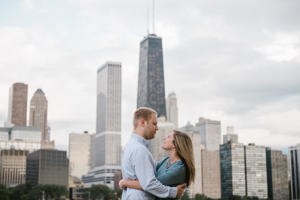 olive park, lake shore east park, milton lee olive park, hancock tower, hancock building, skyline, chicago, engagement, session, couples, iron and honey photography, photographer, lakeshore east park, lakeshore east, lifestyle, relaxed, fun, couple
